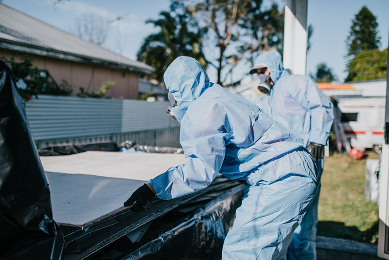 A person working on asbestos disposal in Newcastle